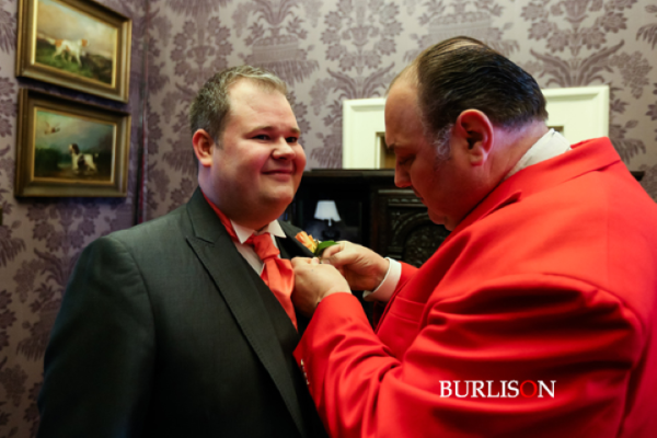 All fingers and thumbs with the buttonhole, thank goodness the Toastmaster was on hand to help the Groom