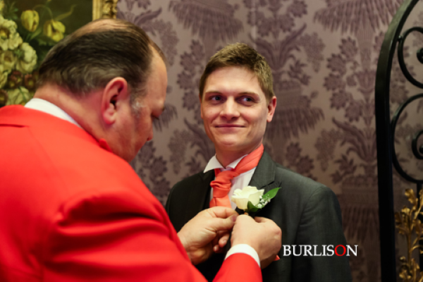 Take a deep breath and let the Toastmaster take charge, another Groom needing a steady hand on their buttonhole