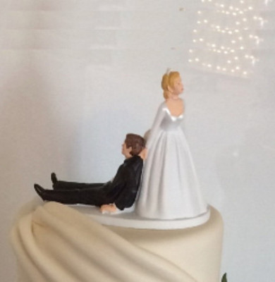 Michael and Natalie's wedding cake with their rather special wedding cake topper