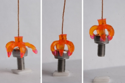 a 3d printing shape memory polymer grasping a screw. Photo courtesy of Qi (Kevin) Ge