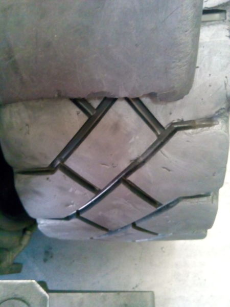 Re-grooved drive tyre.