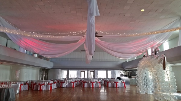 Draping with red spot lights.