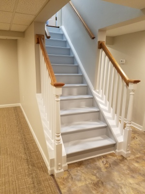 AFTER - COMPLETELY FINISHED BASEMENT WITH NEW STAIRCASE