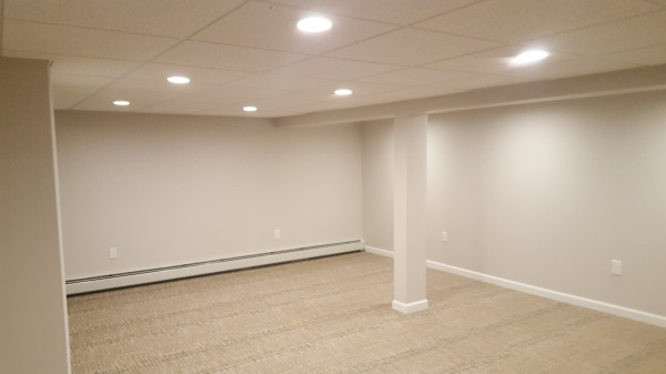 BASEMENT RENOVATION WITH BASEBOARD HEAT INSTALLED