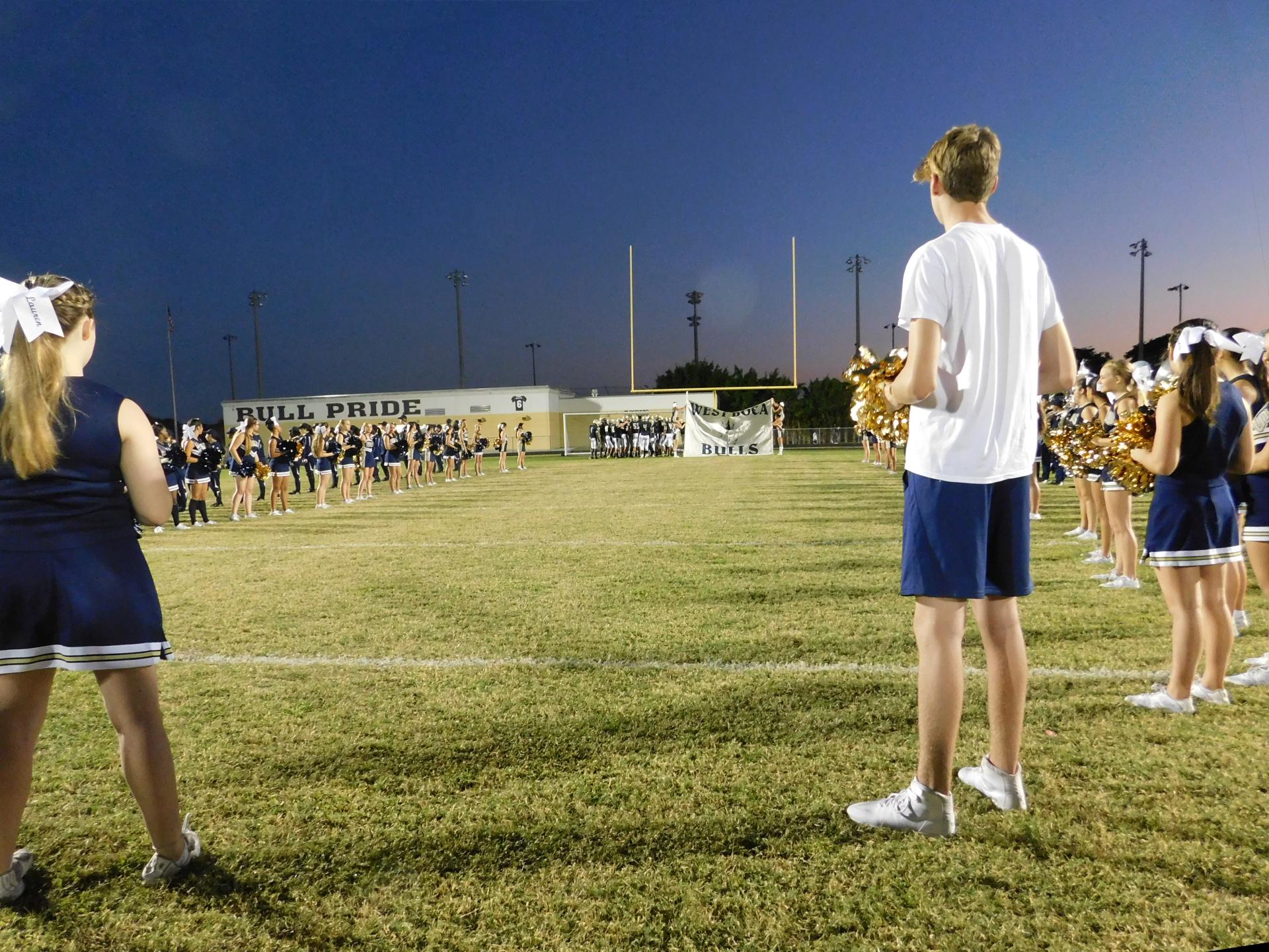 Jimmy Burns cheering at a Football Game   Photo by Meghan Zaffuta