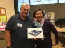 Winner Bernardine Bowersox receiving  her new Samsung Tablet  from LWCC President David Merritt