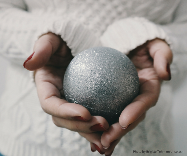 girl holding silver bauble
