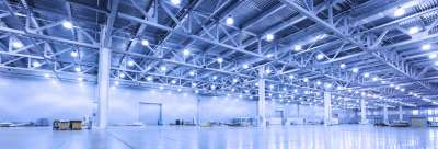 view of warehouse emphisizing lighting on ceiling