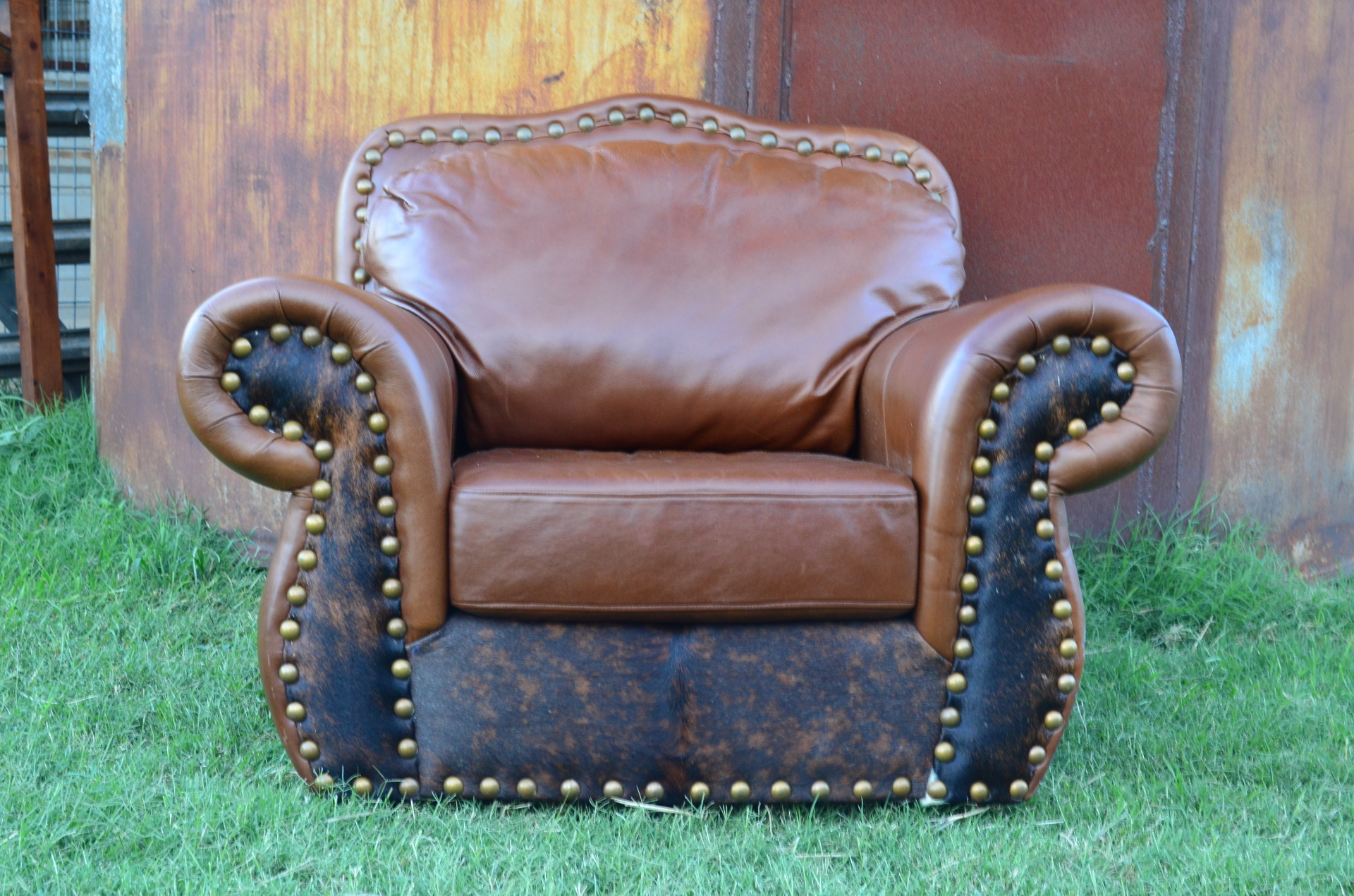 Leather and Cowhide Glider/ Swivel Chair