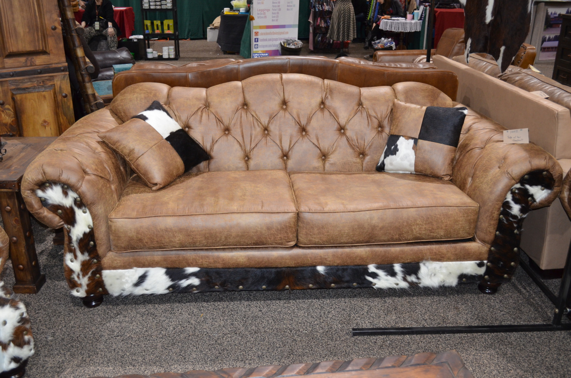 Chestnut Sofa with Cowhide. $1448