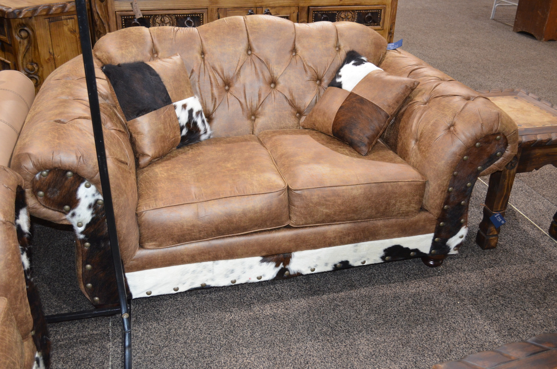 Chestnut Loveseat with Cowhide. $1398