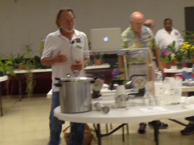 Steve demonstrating orchid flasking