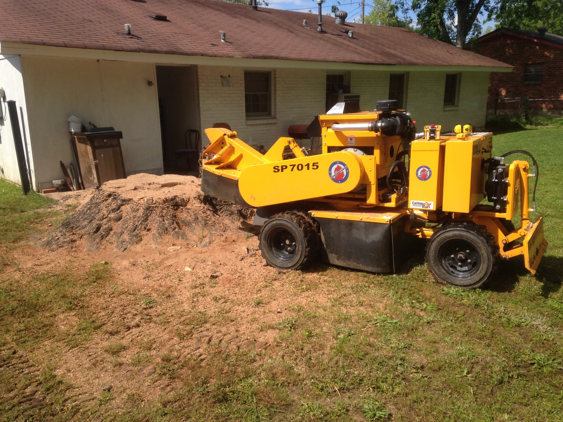 Grinding a giant stump in Tuskegee