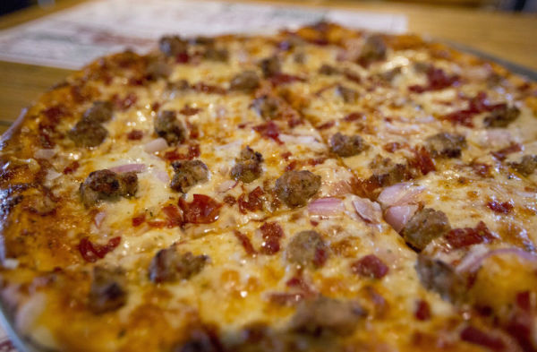 A Capicola and onion Pizza