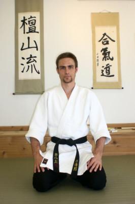 Marek Kozlowski kneeling