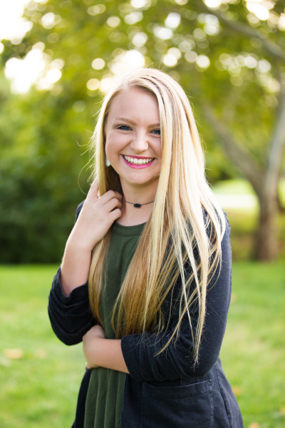 senior girl posing for camera at will rogers park in oklahoma city oklahoma