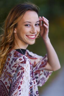 senior girl looking back at camera at myriad gardens in oklahoma city oklahoma
