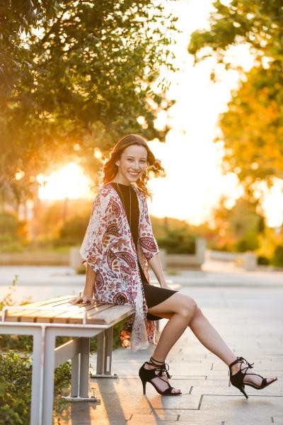 senior girl sitting on bench at myriad gardens in oklahoma city oklahoma