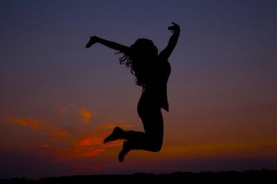 silhouette of senior girl jumping in harrah oklahoma
