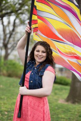 senior girl with flag at myriad gardens in oklahoma city oklahoma