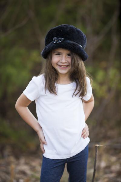 little girl wearing white shirt and black hat posing for camera in harrah oklahoma