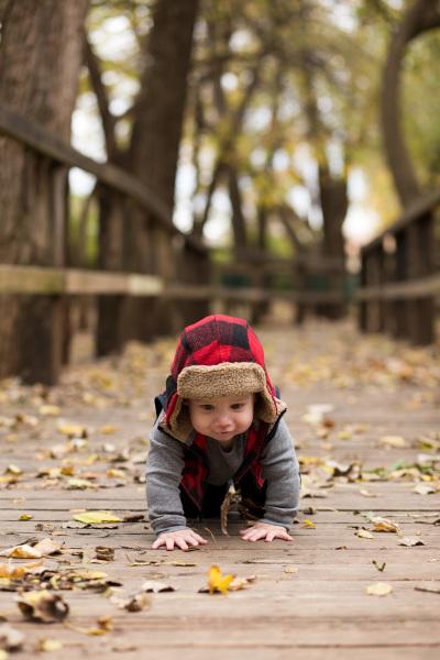 little boy crawling on bridge in oklahoma city oklahoma