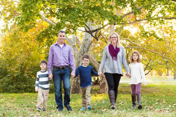 family of 5 walking holding hands at will rogers park in oklahoma city oklahoma