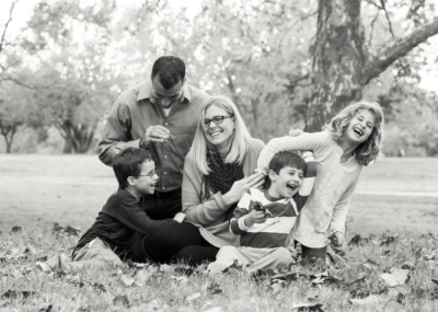 black and white photo of family tickling each other at will rogers park in oklahoma city oklahoma