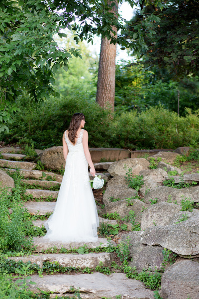 bride standing on rock staircase in tulsa oklahoma