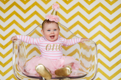 little girl wearing pink tutu sitting in clear chair in studio oklahoma city photographer