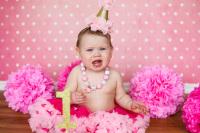 little girl wearing pink tutu at cake smash in studio oklahoma city photographer