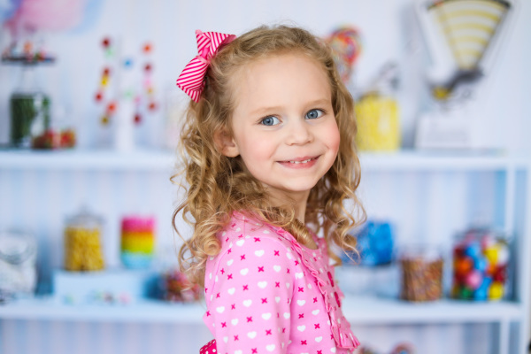 little girl wearing pink dress and pink bow in studio oklahoma city photographer