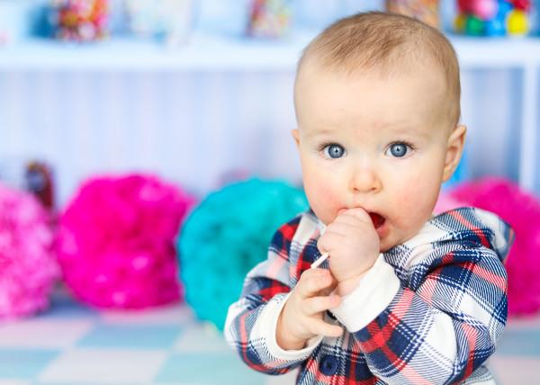 little boy with bright blue eyes sucking on a lollipop oklahoma city photographer