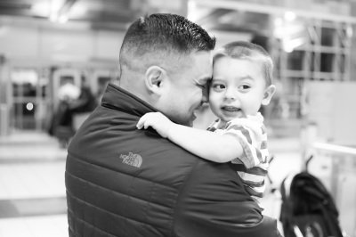 Father and son reuniting at airport in Oklahoma City