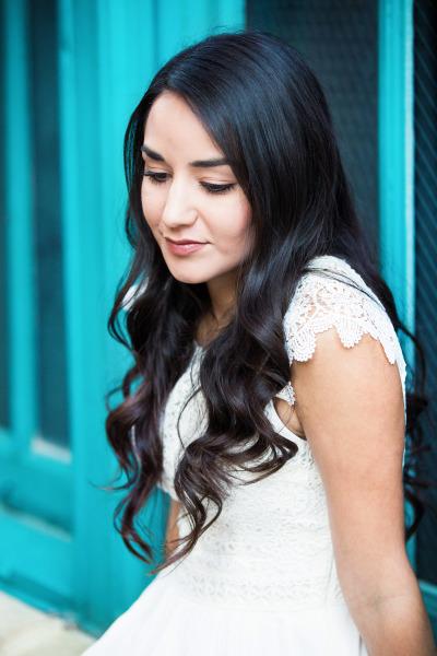 senior girl with brown hair wearing white dress in tulsa oklahoma