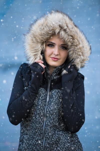senior girl standing in snow in oklahoma city oklahoma