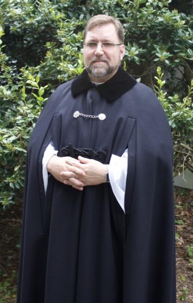 Cappa negra (black cloak) over vestments