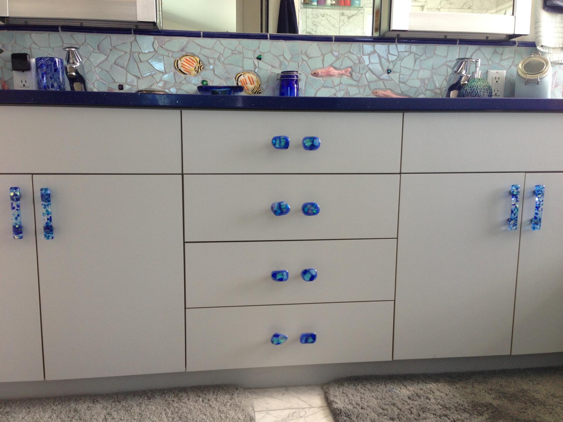 Blue handmade glass bathroom hardware by Torch Lake Glass