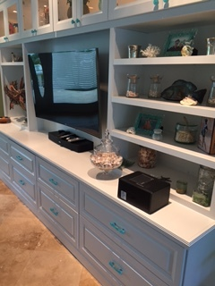 Turquoise cabinet hardware installed on built-in entertainment center