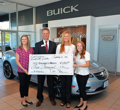 General Manager Dan Boyer presented a $5,000 Check