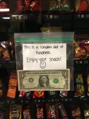Tape money to a vending machine.