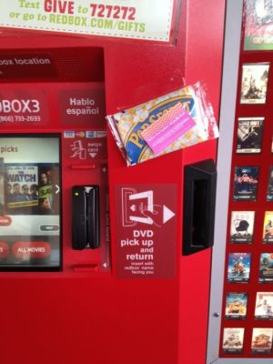 Tape a bag of popcorn to a Redbox rental machine.