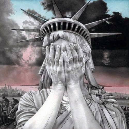 Satue of Liberty hands over face crying.