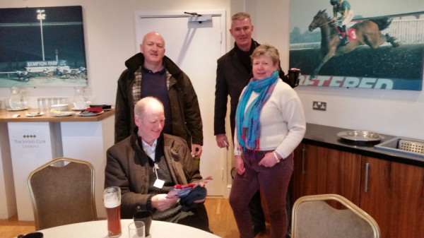 Members Penny & Paul Cregan, Jerry Squires & his guest, Sean studying his complimentary racecard.