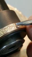 hand engraving 14 karat gold wedding band at maf goldsmith