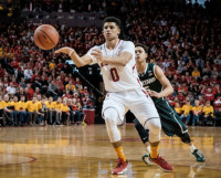 Tai Webster of Nebraska passing during a basketball game