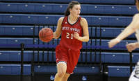Stella Beck of Saint Mary's College dribbling during a basketball game