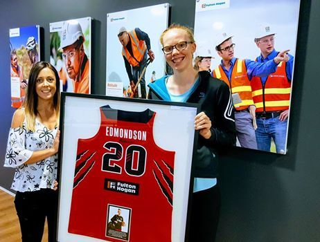 Abby Shaw, Fulton Hogan's New Zealand Manager - Group Communications receiving the signed playing strip from WBC MVP Fran Edmondson.