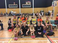 Ashlee Fane and Terina Wanoa pose with Pioneer's Year 7/8 girls basketball team