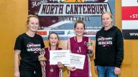 Ashlee Fane and Courtney Hamblin presenting awards to some hard-working players out in North Canterbury.